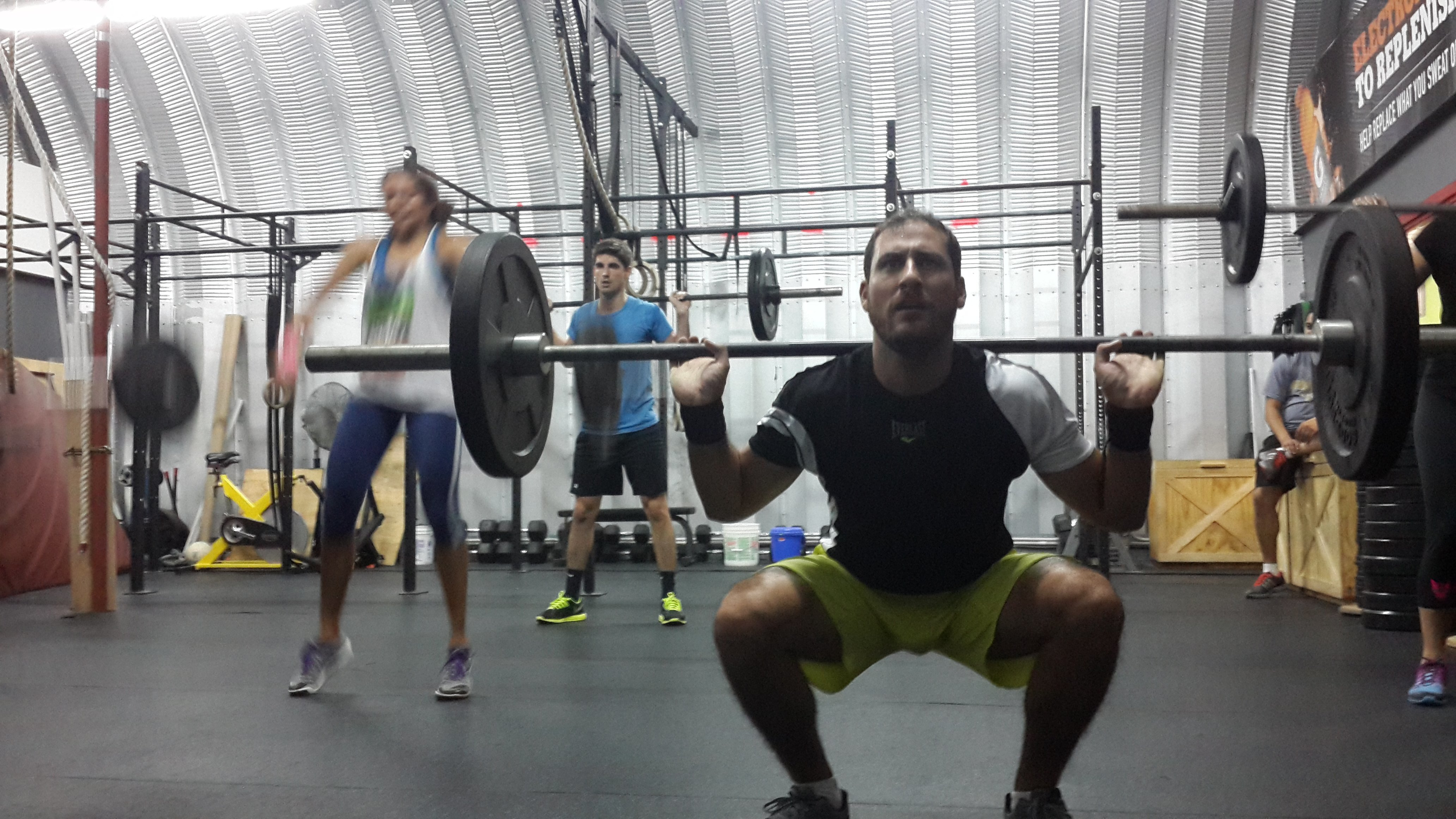 Matias in the bottom of the Squat during the Hell Deck WOD